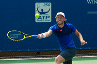 Lucas Pouille returns a serve during the Winston-Salem Open