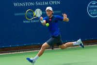 Lucas Pouille runs down a volley at the Winston-Salem Open
