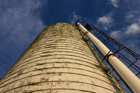 Grain Silo with Clouds and Blue Sky